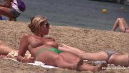 Sexy milf with massive boobs on topless beach
