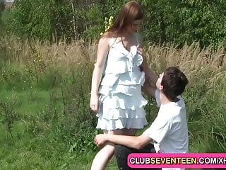 Breasty pale teenager stuffed outdoors